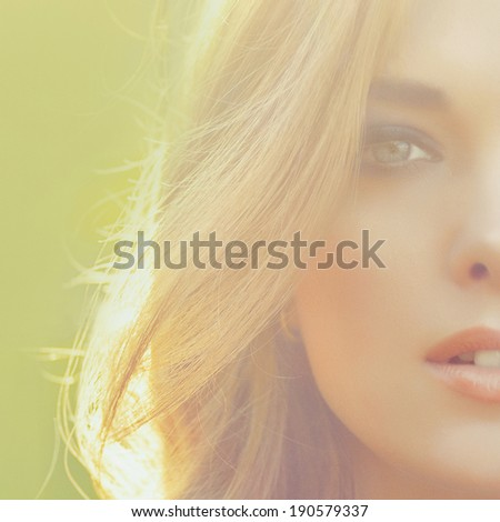 portrait of a young beautiful girl in sunlight outdoor - stock photo