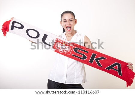 Portrait of a young beautiful girl poland fan. - stock photo