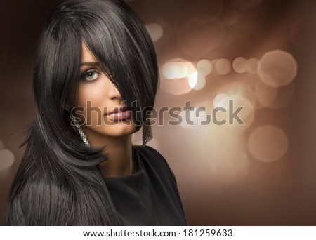 portrait of a young beautiful girl with shiny hair on the background bokeh - stock photo