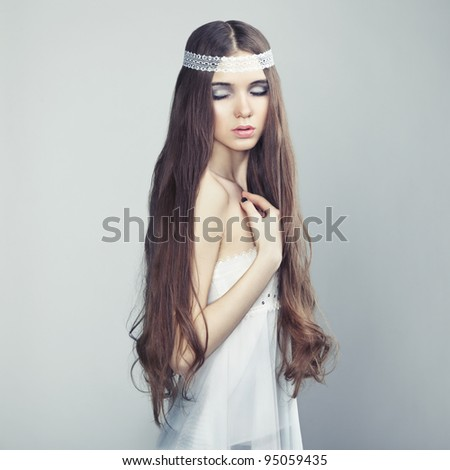 Portrait of a young beautiful girl with wavy hair - stock photo