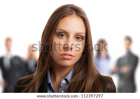 Portrait of a young beautiful woman in front of a group of people - stock photo