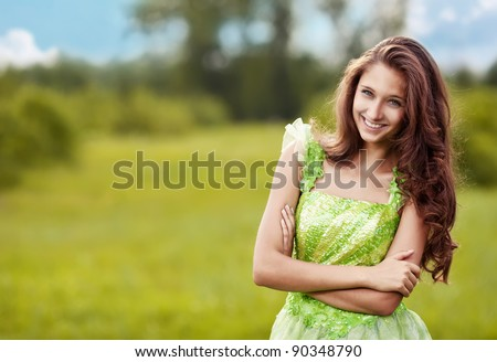 Portrait of a young beautiful woman on the nature - stock photo