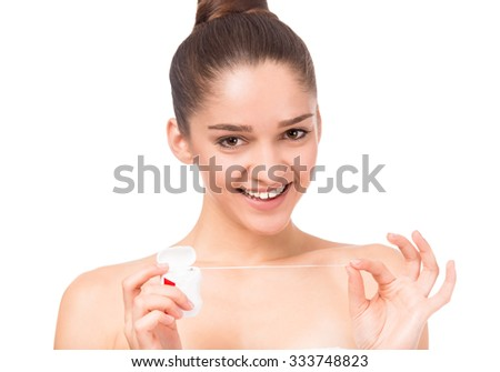 Portrait of a young beautiful woman with dental floss, isolated on a white background - stock photo