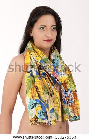 Portrait of a young black-haired woman with a scarf / On the skin, the beauty shines - stock photo