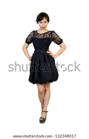 Portrait of a young blonde attractive girl in black dress isolated over white background - stock photo