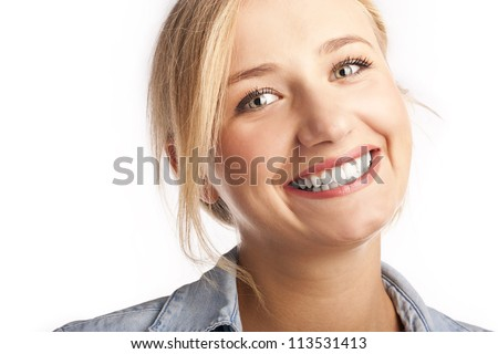 Portrait of a young blonde woman. Closeup - stock photo