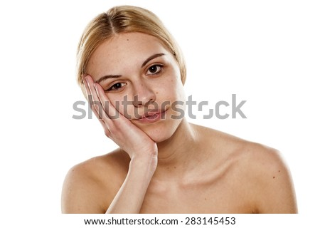 portrait of a young bored woman with no makeup - stock photo