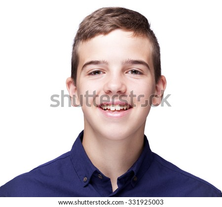 Portrait of a young boy looking at camera and smiling, isolated on white background - stock photo