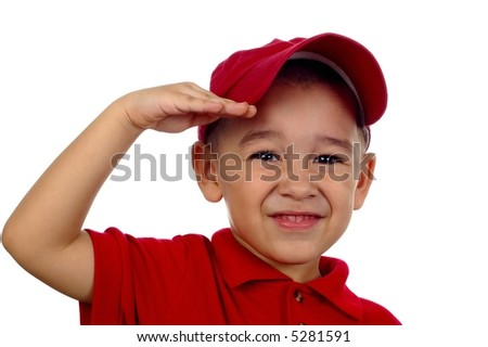 Portrait of a young boy saluting and smiling - stock photo