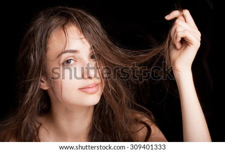 Portrait of a young brunette beauty with shiny wet hair. - stock photo