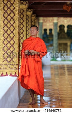 Portrait of a young Buddhist monk, Laos - stock photo