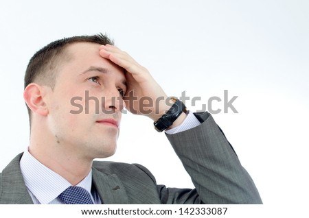 Portrait of a young business man looking depressed - stock photo