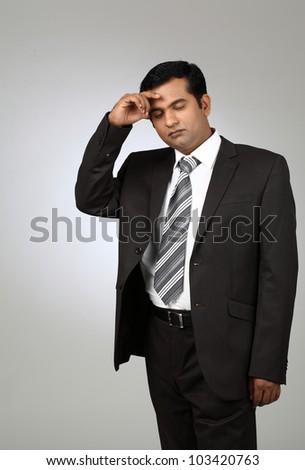 Portrait of a young business man looking depressed from work - stock photo