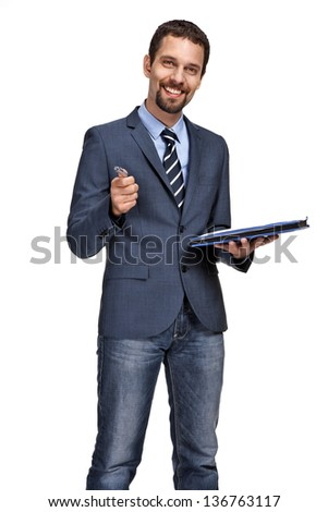 Portrait of a young business man showing at you with pen in hand - stock photo