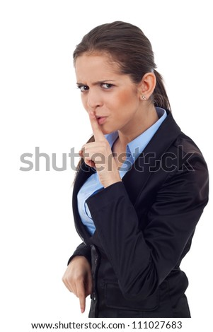 Portrait of a young business woman making you the silence sign over white background - stock photo