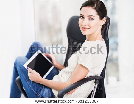 Portrait of a young business woman using digital tablet - stock photo
