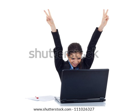 Portrait of a young business woman victorious behind laptop. isolated on white - stock photo