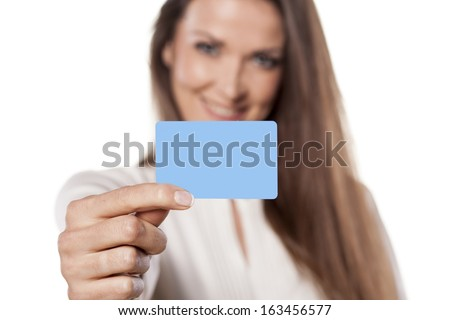 portrait of a young business woman who held in the hand blank credit card - stock photo