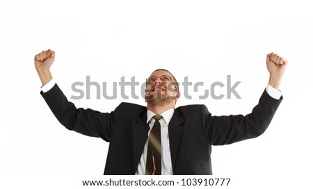 Portrait of a young businessman in suit and tie, wearing glasses, lifting both hands up in joy and success - isolated on white - stock photo