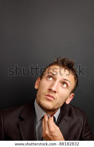 portrait of a young businessman on gray background - stock photo