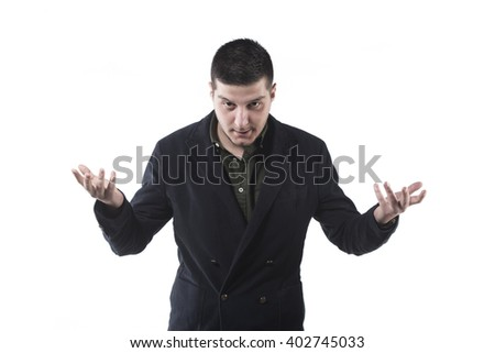 portrait of a young businessman pointing and looking serious on a white background - stock photo