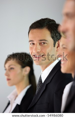 Portrait of a young businessman smiling - stock photo