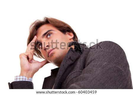 Portrait of a young businessman thinking, in autumn/winter clothes, isolated on white. Studio shot - stock photo