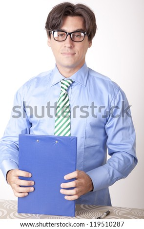 Portrait of a young businessman working in his office. - stock photo