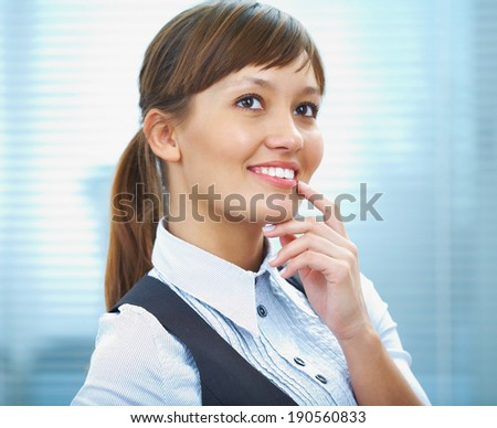 portrait of a young businesswoman smiling against the office background - stock photo