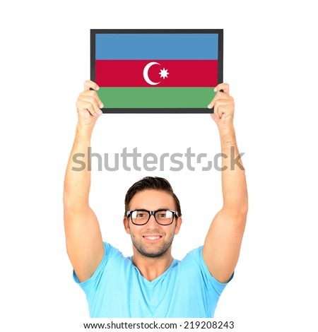 Portrait of a young casual man holding up board with National flag of Azerbaijan - stock photo