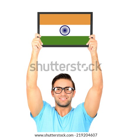 Portrait of a young casual man holding up board with National flag of India - stock photo
