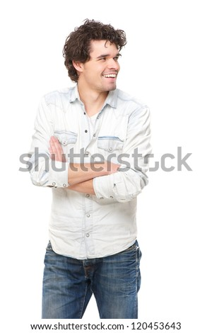 Portrait of a young casual man smiling on white background. He has his arms crossed and looking to the side - stock photo