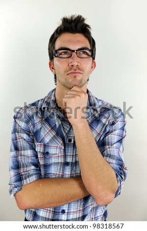 portrait of a young casual man thinking - stock photo