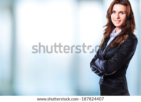 Portrait of a young confident business woman smiling - stock photo