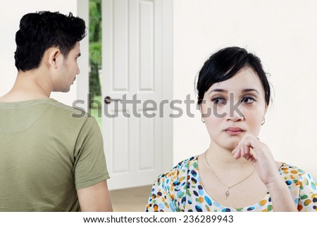 Portrait of a young couple after an argument in their home - stock photo
