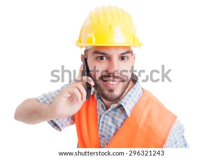 Portrait of a young engineer or builder talking on the phone - stock photo