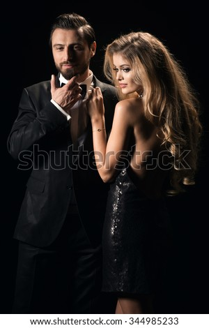 Portrait of a young fashion couple looking into the camera  - stock photo