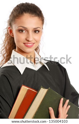 Portrait of a young female judge holding law books - stock photo