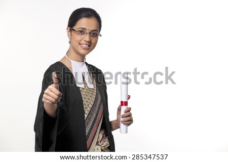 Portrait of a young female lawyer showing thumbs up sign isolated over white background - stock photo