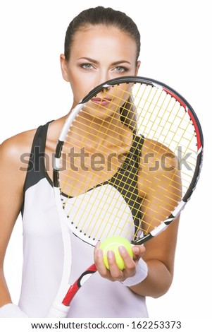Portrait of a Young Female Tennis Sportswoman Player With New Tennis Racquet Crossing Along Face. Isolated over Pure White Background. Vertical Image - stock photo