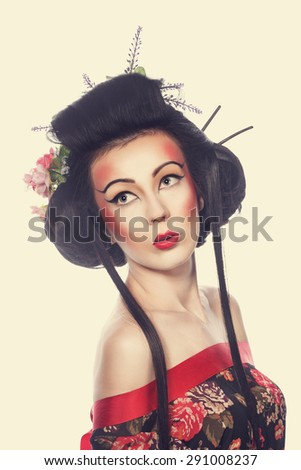 Portrait of a young geisha girl. Bright creative makeup and hairstyle. The concept of Asian beauty. - stock photo