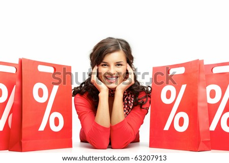Portrait of a young girl among discount paper bags - stock photo
