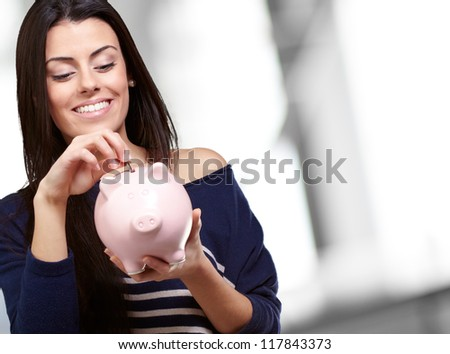 Portrait Of A Young Girl Holding A Piggy Bank, Outdoor - stock photo