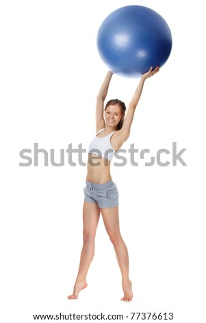 Portrait of a young girl holding gymnastic ball - stock photo