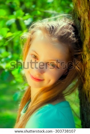 Portrait of a young girl in a park - stock photo
