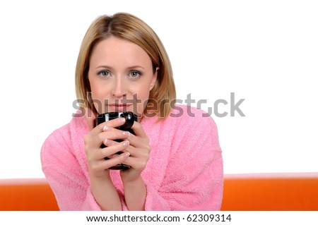 Portrait of a young girl in a pink gown with a mug in his hands. - stock photo