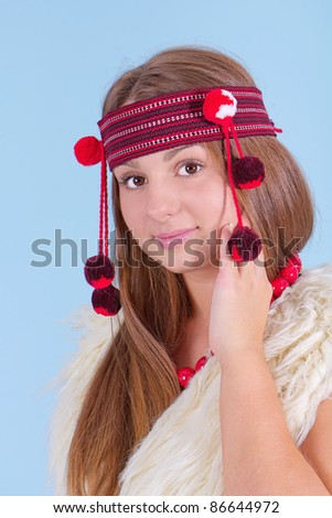 Portrait of a young girl in national dress - stock photo