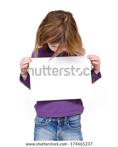 Portrait of a young girl looking at blank sign on isolated white background - stock photo