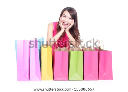 Portrait of a young girl lying with shopping bags and show thumb up isolated on white , asian beauty - stock photo
