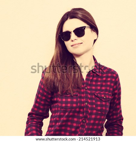 Portrait of a young  girl wearing trendy glasses and casual shirt and posing. Hipster style. Close up. Photo with instagram style filters - stock photo